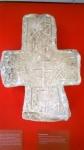 Закладной крест. Новгород. Вт. пол. XIV в. Белый известняк. Вокруг креста выпуклые крупные подписи с монограммами Христа